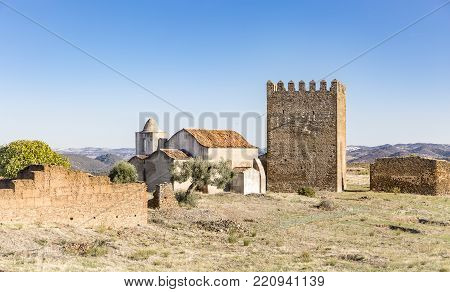 Tower of Homage and the church inside the Castle of Noudar, Barrancos, district of Beja, Portugal