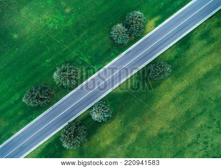 Aerial View Of Road Through Beautiful Green Field