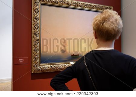 ST. PETERSBURG, RUSSIA - MARCH 21, 2017: Visitor in the exhibition of Ivan Aivazovsky in the Russian Museum. More than 300,000 people visited the exhibition