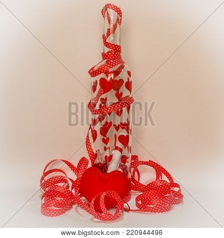Valentine's Day message in the bottle   with harts on it and a red ribbon around it