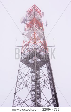 Metal viewfinder with transmitters in the fog. Tourist tower in the Czech Republic