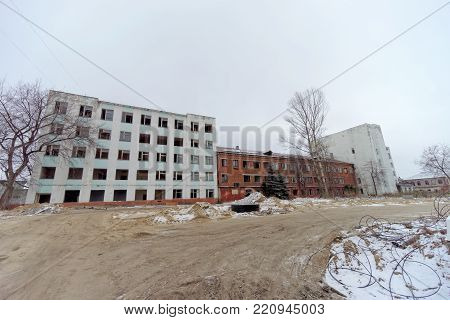 Nizhny Novgorod, Russia. - December 1.2017. Accomplishment of territory near the football stadium in Nizhny Novgorod to the FIFA World Cup 2018. Buildings next to the stadium intended for demolition.