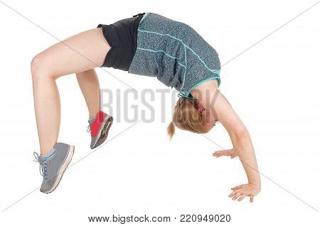 A lovely young woman making a bridge backwards in her gymnastic  exercise in shorts and seekers, isolated for white background