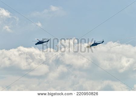 Nizhniy Tagil, Russia - July 12. 2008: Russian military helicopters mi-24 shoot from machine guns and let out thermal traps. Russia Arms Expo-2008