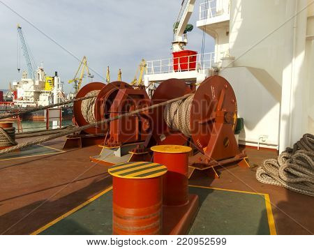 Novorossiysk, Russia - August 20, 2017: Mechanisms of tension control ropes. Winches. Equipment on the deck of a cargo ship or port.