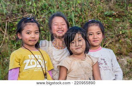 YUANYANG, YUNNAN, CHINA - NOVEMBER 04 2013: Happy Chinese girls in the village of Yunnan Province