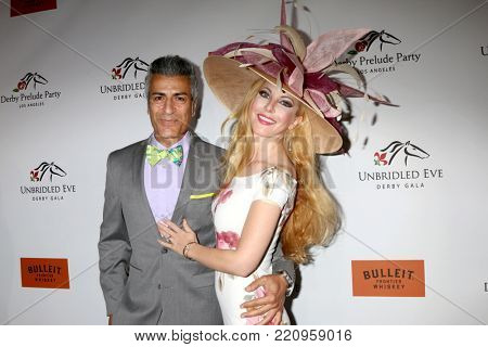 LOS ANGELES - JAN 5:  Medi Em, Dustin Quick at the Unbridled Eve Derby Prelude Party Los Angeles at the Avalon on January 5, 2018 in Los Angeles, CA