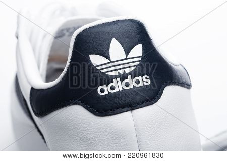 LONDON, UK - JANUARY 02, 2018: Adidas Originals shoes on white background. German multinational corporation that designs and manufactures sports shoes, clothing and accessories.