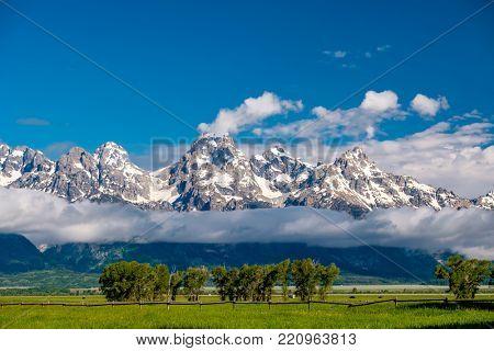 Grand Teton Mountains with low clouds. Grand Teton National Park, Wyoming, USA.