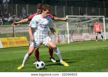 KAPOSVAR, HUNGARY - MAY 14: Milan Peric (in white) in action at a Hungarian National Championship soccer game - Kaposvar vs Szolnok on May 14, 2011 in Kaposvar, Hungary.