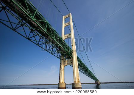 The Mackinac Bridge. Close up view of the center span of the Mackinaw Bridge in Michigan, The Mackinaw is one of the longest suspension bridges in the world and part of Interstate 75.