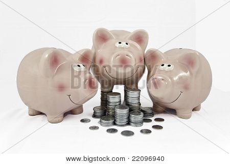 pink piggy banks feasting on column of coins