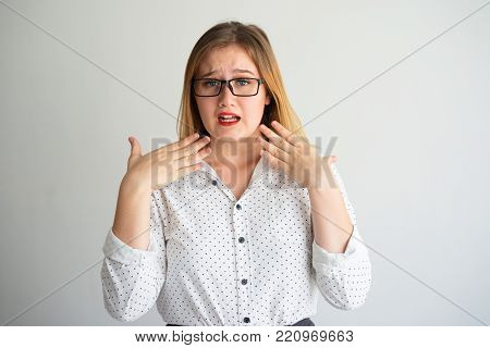 Anxious smart female student worrying before exam and waving hands trying to calm down. Nervous young woman stressed out. Fear concept