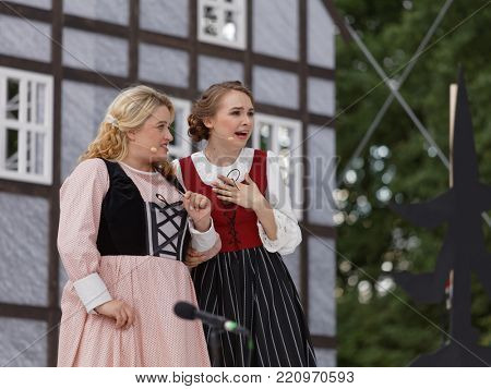 ST. PETERSBURG, RUSSIA - JULY 19, 2017: Micaela di Catalano (left) and Olga Cheremnykh in the opera The Marksman of C. M. von Weber outdoors during the festival All Together Opera