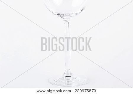 Cropped image of empty glass. Empty glass for wine on white background, cropped image.