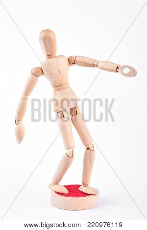 Action of wooden human dummy. Yellow wooden dummy in action on white background.