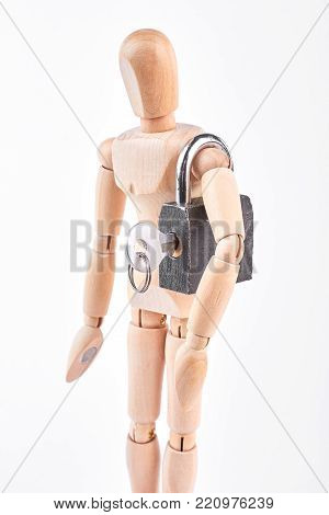 Wooden dummy with padlock on shoulder. Grey padlock with key on shoulder of wooden mannequin, white background. Protection and security, psychology concept.