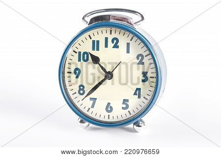 Blue retro alarm clock, white background. Classic mechanical bell clock isolated on white background. Vintage alarm clock.