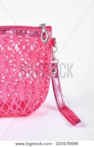 Pink cosmetics bag, cropped image. Beautiful pink bag for toiletry isolated on white background.