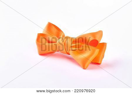 Beautiful yellow hair bow for girs. Fashion accessory for girls hair isolated on white background. Elegant hair accessory for kids.