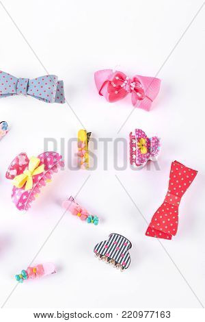 Stylish kids hair accessories. Set of toddler hairpins, claws and bow ties on white background. Kids fashion design hair accessories.