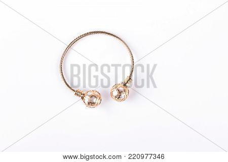 Female bijouterie bracelet on white background. Woman bangle isolated on white background.