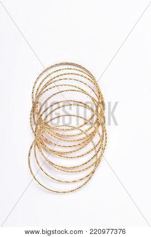 Collection of golden bracelets on white background. Set of female beautiful bracelets isolated on white background.