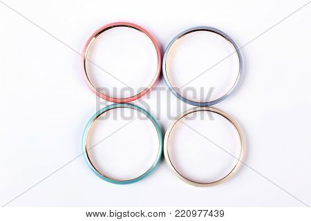 Female modern bracelets, top view. Woman colorful wrist bands on white background.