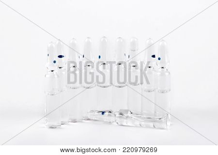 Set of medical ampoules with liquid. Glass ampules with medicine liquid for injection on white background.