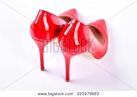 Luxury red heels for woman. Red elegant shoes on high heels isolated on white background. Woman fashion and style.
