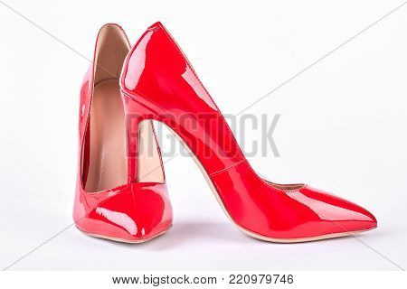 Woman modern red high heels. Pair of red stilettos isolated on white background. Female classic footwear.