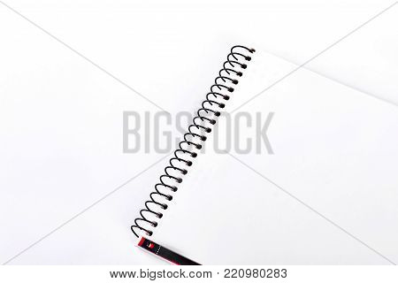 Spiral binder notebook, white background. Open empty notepad with clipping path. Blank page of notebook, white background.