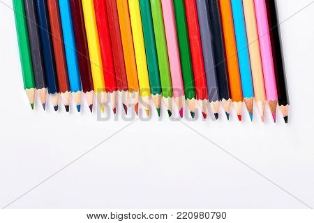 Variety of multicolored pencils for drawing. Collection of colorful pencils isolated on white background. Objects for drawing at school and kindergarden.