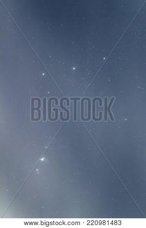 Orion Belt, Cloudy Night sky Background Night.