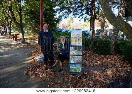 PETOSKEY, MICHIGAN / UNITED STATES - OCTOBER 18, 2017: Jehovah's Witness missionaries offer free religious literature, in Petoskey's Bayfront Park.