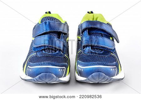 Sport trainers on white background. Blue and green sport shoes isolated on white background. Pair of new sport shoes.