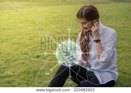 Happy asian Beautiful young woman listening the song and using the social network via smart mobile phone for online shopping with omni channel in the park, lifestyle and technology concept, 3D illustration