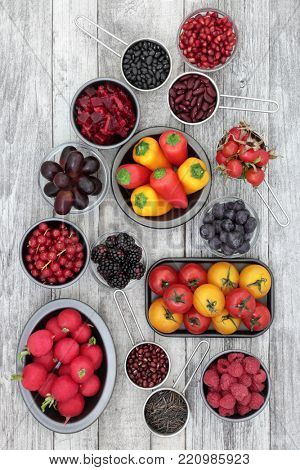 Healthy super food selection of fruit, pulses, vegetables and grains high in anthocyanins, antioxidants and vitamins. Health promoting foods concept. Top view.