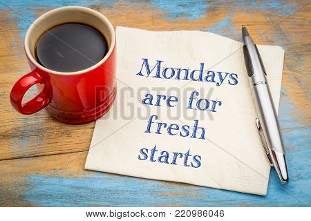 Mondays are for fresh starts - motivational handwriting on a napkin with a cup of coffee