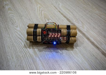 Image of a time bomb on floor. Timer counting down to detonation illuminated in a shaft light shining through the darkness, conceptual image