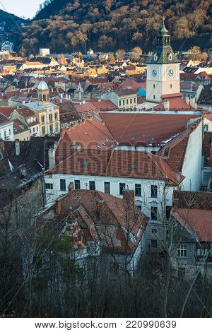 Brasov, Transylvania, Romania - Novemrer 19, 2016: the central square of the old town. Brasov. Transylvania. View from above. The buildings, the people on the square like little ants.