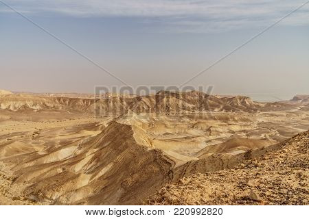 Beautiful nature desert in dry judean picturesque wilderness. Outdoor scenic landscape of mountains, sand and rocks near the dead sea. Travel in middle east