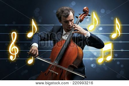 Young handsome cellist playing with music sheet background