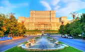 One of the famous and biggest building in the world Palace of Parliament illuminated by sunrise light in the most beautiful place of Bucharest, capital of Romania in Eastern Europe poster