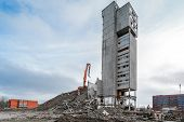 highrise industrial building demolition with hydraulic excavator poster