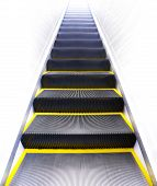 Moving up modern escalator with yellow line. poster