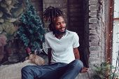 African American man with dreadlocks and a white T-shirt. Mock-up. poster