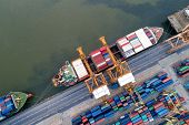 Aerial view of Containers yard in port congestion with ship vessels are loading and discharging operations of the tranport in international port. poster