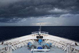 Cruise ship sailing into a storm in the Bahamas.