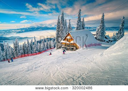 The Best Popular Winter Ski Resort With Skiers In Romania. Amazing Touristic And Winter Holiday Dest